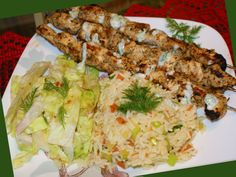 Souvlaki pork, rice and salad