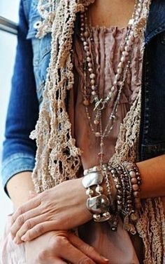 Bohemian-look ensemble: crinkly dress with lace-trimmed leather jacket and lots of jewelry!