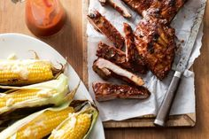 Barbecued pork ribs with grilled corn and parmesan butter