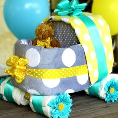 Almost everything on this baby carriage diaper cake is useable.