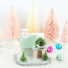 Step-by-step tutorial for adding realistic snow and frost to tiny paper houses.