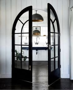 Bathroom with arched black doors, large trough sink...rustic chic.