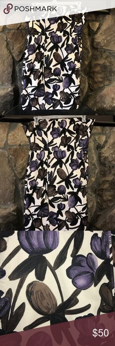 "💜BANANA REPUBLIC💜 STRAPLESS FLORAL DRESS💜 This is a stunning dress with brown and purple floral strapless dress by our beloved banana republic. Back zipping eyelet hook with rubber backing for staying power some boning in the bodice  area for shaping. No Flaws. Fully lined. 98% cotton 2% spandex/elastane. Lining 100% polyester. Bust 19"" waist 18, hips 20"" and length 27"". Banana Republic Dresses Strapless"