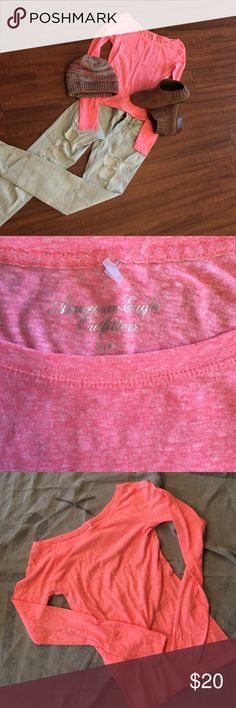 American Eagle Outfitters Brand New, NEVER worn💞 Long sleeve, coral or peachy in color🎀great addition for any closet💖. Tag itself has been taken off but hanging part for tag is still in position as shown in close up pic💖 American Eagle Outfitters Tops