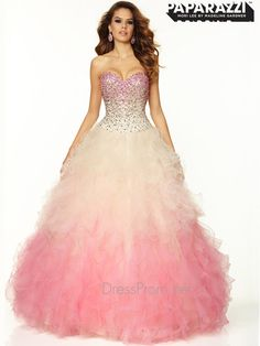 This spectacular Paparazzi ball gown prom dress is fit for a princess. The Paparazzi 97021 is a sweetheart prom dress with fitted bodice, which is adorned with jeweled beading, and a corset back closure to get a great fit. A gorgeous tulle ball gown skirt with multiple ruffles completes this Paparazzi prom dress. Finish this amazing Paparazzi ball gown dress with long crystal earrings and matching bracelet at DressProm.net. Features:  Silhouette: Ball Gown  Neckline: Sweetheart  Fabric: ...