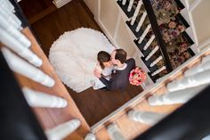 Birdseye staircase wedding shot, such a unique and artistic photo idea! | Claire Diana Photography |