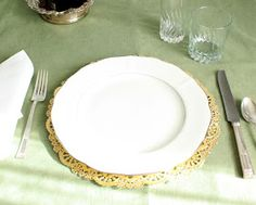 Large gold doilies work great as charger or place mats for wedding table or parties.