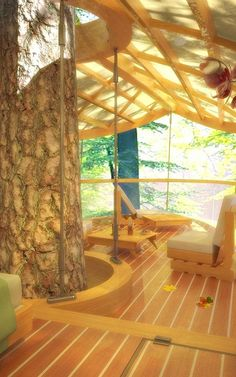 These Amazing Hanging Hotel Rooms Let Guests Camp In Trees  Inside, this treehouse has all the amenities of a suite at the Hilton. On the outside, all you'll see is nature all around.
