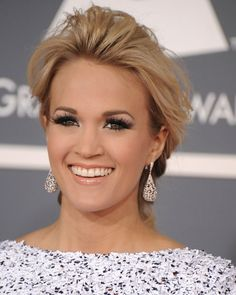 Carrie Underwood never fails to make me want to wear a paper bag over my head. She's so pretty!