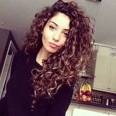 Perfect curls ugh I want my name to do this instead of naturally frizzling!