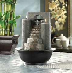 Eternal Steps Water Fountain: Fire and water combine to form one spectacular decoration! Cascades of water trickle down faux-stone steps, while tea lights glimmer from atop twin pillars. A tabletop fountain to treasure! Fountain Candles, Tabletop Water Fountain, Indoor Fountain, Fountain Ideas, Fountain Design, Home Fountain, Bamboo Fountain, Fountain Garden, Garden Water