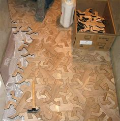 Arbore, a flooring contractor in Madrid, Spain, created these awesome interlocking hardwood pieces in the form of M.C. Escher's famous geometric Reptiles.