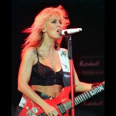 """Lita Ford, could sing, could play, and wasn't too shabby to look at either. """"Kiss Me Deadly"""", """"Close My Eyes Forever"""" (with Ozzy), and her remake of Alice Cooper's """"Only Women Bleed"""" are awesome."""