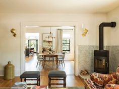 In a historic Cambridge, Massachusetts house remodel, Barbara Bestor celebrated classic New England design while introducing California comforts. Small Living, Living Spaces, Living Room, Boston House, New England Homes, Oval Table, House Inside, Painted Chairs, California Homes