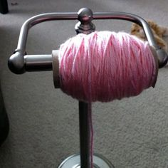 lol Toilet paper stand re-purposed into yarn dispenser. Wrap your yarn on discarded TP tubes for storage and pop a roll onto the stand for easy dispensing while you knit or crochet. Would be awesome for twine on a work table too.