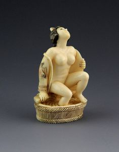 JAPANESE CARVED IVORY NETSUKE BATHING GEISHA Japanese carved ivory netsuke…
