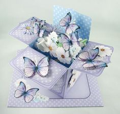 3D Flowers Butterflies Rubber Band Pop Up Box Card on Craftsuprint designed by Carol Clarke - made by Carolyn Norris - I printed the sheets on quality cardstock and cut out all the elements. I used foam pads to decoupage and double sided tape for the rest of the box card construction. I used craft flower stamens for the antennae/body of the butterflies. The included, illustrated, instructions were easy to follow and the box went together quite quickly. There were plenty of elements for you…