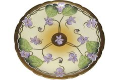"""Exquisite Limoges porcelain plate, hand-painted in African violets with gilding by Stouffer Studios in Chicago at the turn of the last century. Stamped in green """"J.P.L. France"""" for Jean Pouyat Limoges, and stamped in red """"Stouffer Hand Painted."""""""