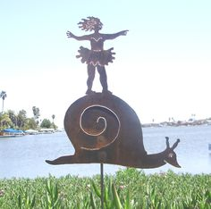 Fa Fa Moon - Girl with tutu on snail, ballerina metal garden sculpture by artist Judie Bomberger, made in the USA.