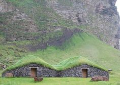 Iceland, houses built into the hill out of necessity, the earth insulates them and protects against the cold.