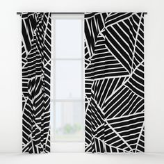 "geometric black and white  curtains - Your drapes don't have to be so drab. Our awesome Window Curtains transform a neglected essential into an awesome statement piece. They're crafted with 100% lightweight polyester, and thick enough to block out some light - just slip your rod into the 4"" pocket and you're good to go. All curtains are a single-sided print and measure 50"" x 84"". Available in single or double panel options. Machine wash cold (no bleach!) and tumble dry low."