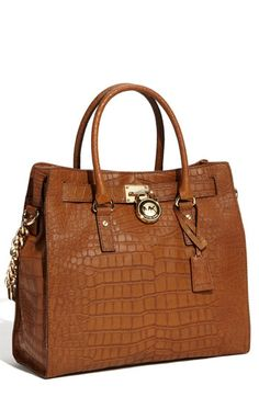 67e8eeafd631 Michael Kors YES. Have my black leather Fossil purse so a brown MK will  complete my purse necessities.