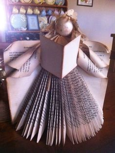 An Angel book folding project Old Book Crafts, Book Page Crafts, Book Page Art, Newspaper Crafts, Christmas Crafts, Folded Book Art, Paper Book, Paper Art, Cut Paper
