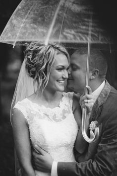 Raining on wedding day. Clear umbrellas on wedding. Wedding portraits in rain. Nashville wedding photography.