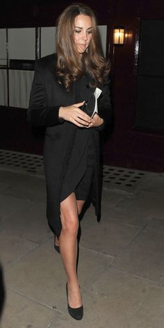OCTOBER 11, 2012 Catherine partied in London with William and sister Pippa Middleton in an all-black look, including a long coat.