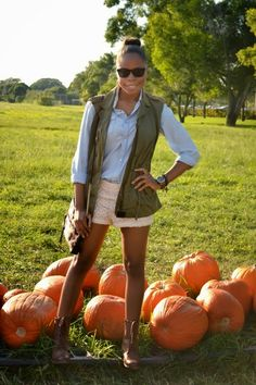 Military Vest + combat boots with shorts... cute look!