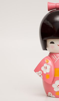 Japanese Kokeshi Doll. I have one of these dolls that I picked up in Osaka, Japan. It always makes me smile.