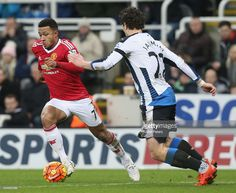 Memphis Depay of Manchester United in action with Daryl Janmaat of Newcastle United during the Barclays Premier League match between Newcastle United and Manchester United at St James' Park on 12 January 2016 in Newcastle Upon Tyne, England.