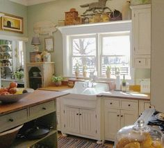 green and white cottage kitchen with Kohler's Gilford utility sink. Belstone via Atticmag