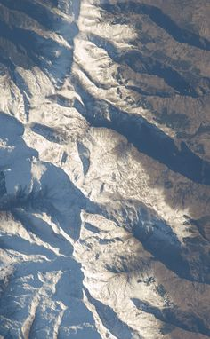 """Seen from Space. The town of Lanjarón nestled beneath the mighty white peaks of the Sierra Nevada. To the north west can be seen the city of Granada and the Sierra de Huetor. South is the Sierra de Lugar and the Alpujarras. Original from  Image Science and Analysis Laboratory, NASA-Johnson Space Center. """"The Gateway to Astronaut Photography of Earth.""""  http://eol.jsc.nasa.gov/scripts/sseop/QuickView.pl?directory=ESC=ISS012-E-11144"""