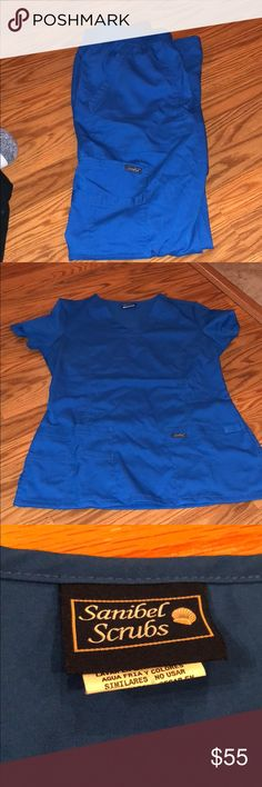 Scrubs size small Only worn 3 times. They're in really good condition. Both top and bottoms are small sanibel scrubs Other