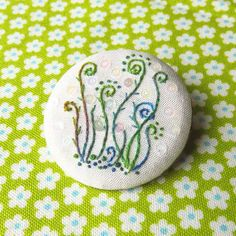 Hand embroidery fern brooch green and blue french knots and  stem stitch with mini sequins.
