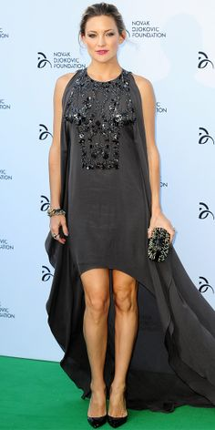 KATE HUDSON At the Novak Djokovic Foundation gala dinner, Kate Hudson turned heads in an intricately beaded dark chiffon Elie Saab dress with a high-low hem, accented by silver rings, a link bracelet and spiked Christian Louboutin pumps and clutch.