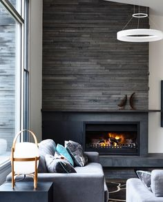 Fireplace within a statement wall without a frame
