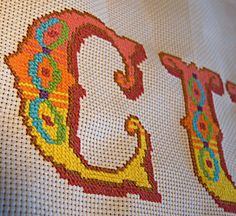 Hook, Line & Sink Her: Completed cross-stitch.  Link to pdf with patterns for full alphabet.