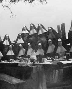 Clustered around the picnic table, sisters pose for a souvenir photo in the summer of 1930. Seated, left to right, Sisters of Saint Joseph (Delphine Nadeau), Berthe Boucher, Gay,?, Lausier, Mance. Standing, sisters Angeline Lavoie, Madeleine Roy, St. Thomas (Martha Albert), Christine Bouchard and Alix Godbout.