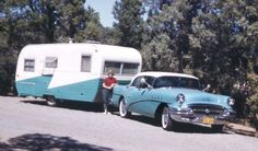 Matching blue and white 1956 buick and camper