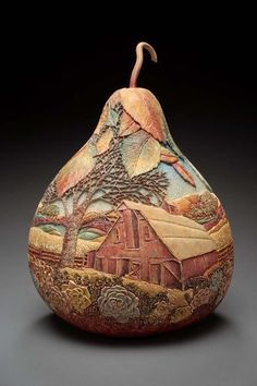 Intricate Gourd Carving by Marilyn Sunderland;  after carving the design on the gourd, she uses oils, acrylics, wood stains or dyes to make the artwork even more impressive