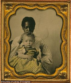 African American woman holding a white child in 1855 - Envisioning Emancipation - Black Americans at the End of Slavery