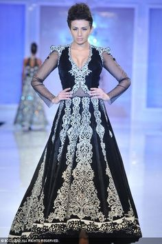 Pia Trivedi walks the ramp to showcase a creation by designer Manav Gangwani during the Day 5 of PCJ Delhi Couture Week 2012 at hotel Taj Palace, New Delhi on August 12, 2012