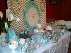I did this table for my sisters baby shower. Found all my glassware at yard sales and goodwill. We got food that matched color theme.  Used a tri-fold board and glued chevron fabric to the back. Used pictures frames (also purchased at yard sales) spray painted and hung them with ribbon.