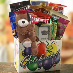 When you can't be there to celebrate the special moment, this festive celebrations gift is sure to do the trick. Bursting with a handsome graduation themed photo album, picture frame and teddy bear, paired with a mouthwatering display of snacks! Cool Gifts, Diy Gifts, Best Gifts, Chocolate Gifts, Chocolate Candies, Gourmet Gift Baskets, Graduation Ideas, Graduation Gifts, Picture Frames