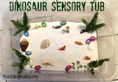 Teaching Mama: Dinosaur Sensory Tub-explore different materials and use imaginary play! Pinned by SOS Inc. Resources. Follow all our boards at pinterest.com/sostherapy for therapy resources.