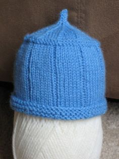 Knit from the bottom up in the round, this cute baby hat knits up quickly for a perfect last-minute gift.