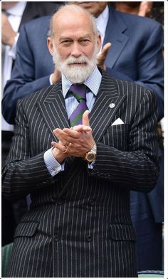 Stripped pattern double breasted suit makes an old man look classy, fresh and enthusiastic.