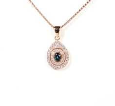 Custom Sarah Hughes Fine Gems design. Rare Alexanderites and diamonds set in rose gold earring and pendant necklace.